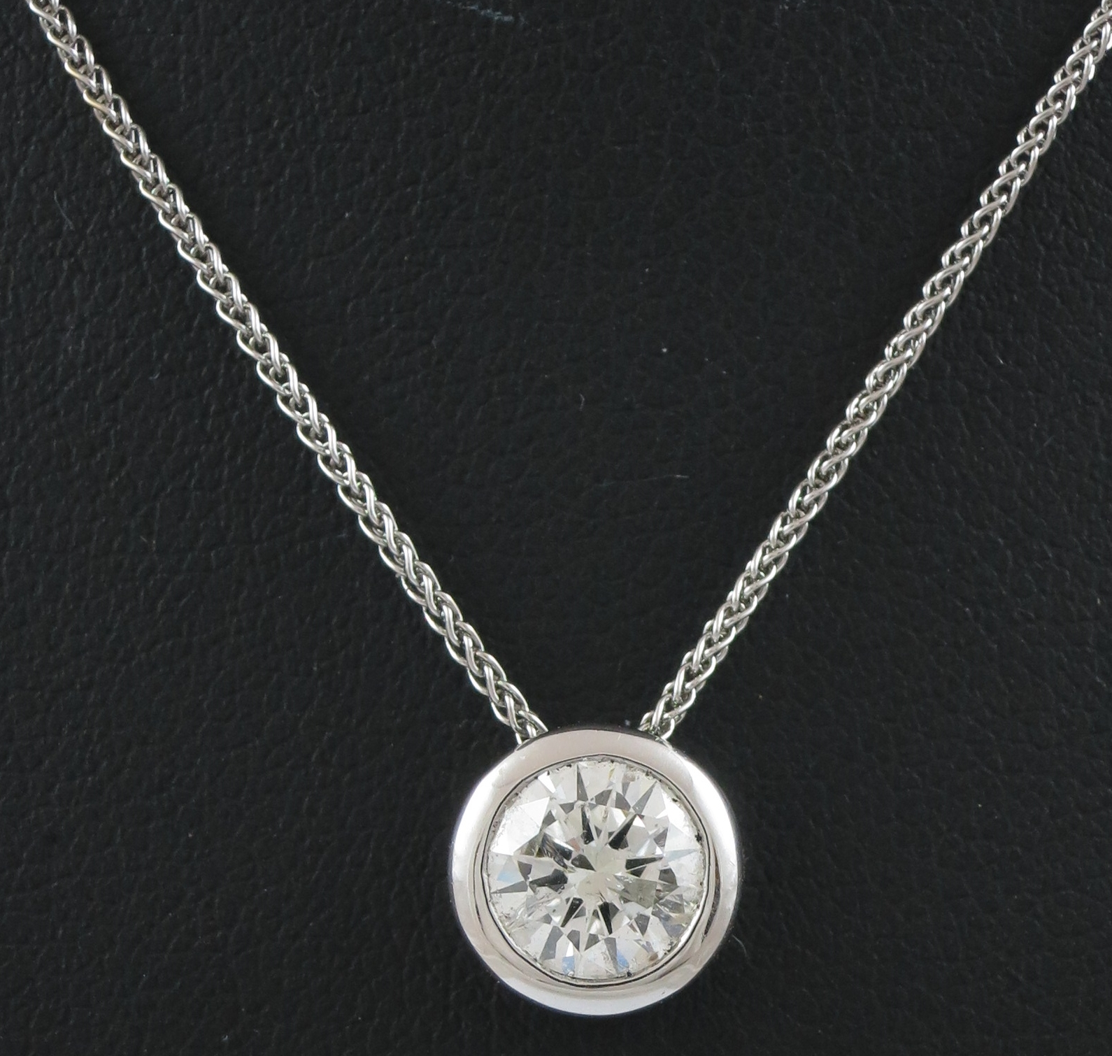 Diamond Solitaire Pendant and Chain.