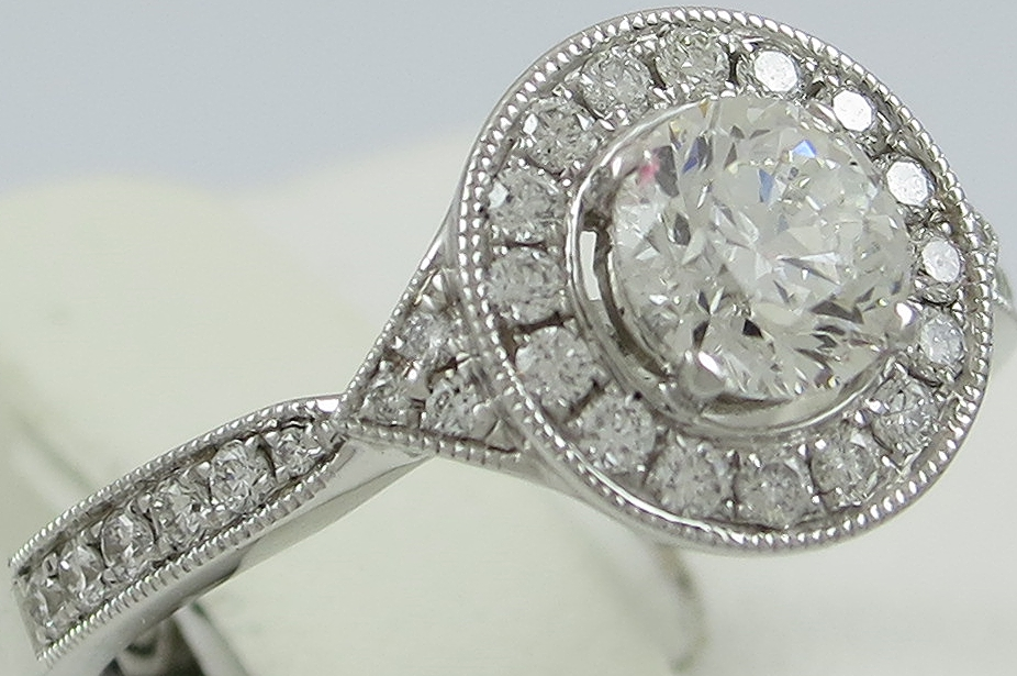 Diamond Halo Style ring with Diamond Set Shoulders