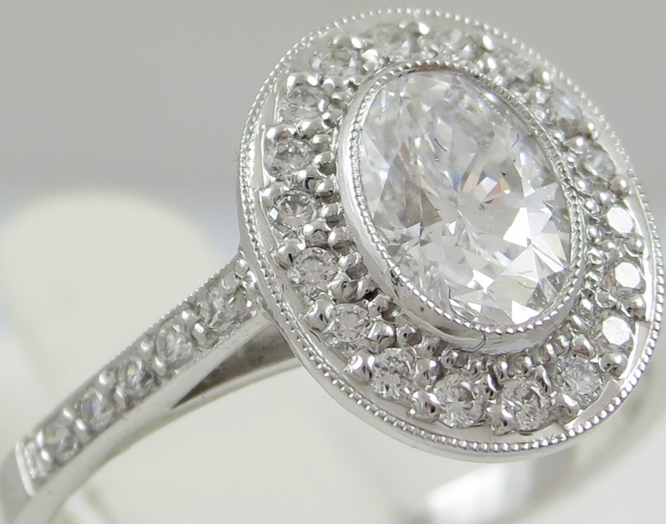 Diamond Mixed cut Halo Style ring with Diamond Set Shoulders